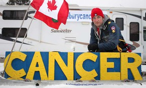 Mike Duhacek, 36, from Milton, Ont., is pictured with his sled that he will be pulling 900 km from Windsor to Ottawa, Sunday, February 3, 2013.  Duhacek is hoping to raise money for Cancer research.  (DAX MELMER/The Windsor Star)
