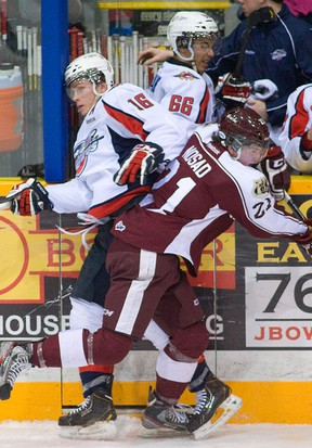 Windsor's Kerby Rychel, left, is checked by Peterborough's Stephen Nosad Thursday in Peterborough. (Peterborough Examiner photo)