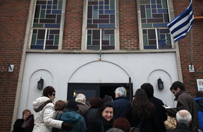Members of Windsor's Greek community wait in line outside the Holy Cross Greek Orthodox Church, Sunday, February 24, 2013, to attend a meeting to discuss the Mayor's proposal of a local Greektown at the former Grace Hospital site. (DAX MELMER/The Windsor Star)