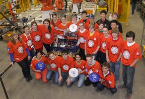 Members of the Sandwich Secondary School robotics team pose Thursday, Feb. 14, 2013, for a group photo at the Centerline Tool facility in Windsor, Ont.  (DAN JANISSE/The Windsor Star)