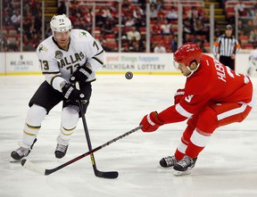 Michael Ryder, right, of the Dallas Stars battles for the puck with Kent Huskins of the Detroit Red Wings during the second period at Joe Louis Arena on Jan. 22, 2013. Huskins was traded to the Philadelphia Flyers on Saturday, March 30, 2013.(Gregory Shamus/Getty Images)