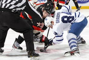 Ottawa's Kyle Turris, left, takes a faceoff against Toronto's Mikhail Grabovski Saturday at Scotiabank Place. (Photo by Jana Chytilova/Freestyle Photography/Getty Images)