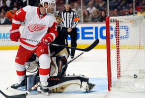 Detroit's Daniel Cleary, left, deflects a shot for a goal past Anaheim goalie Jonas Hiller during the first period of NHL action Sunday, March 24, 2013, in Anaheim, Calif. (AP Photo/Mark J. Terrill)