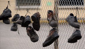 Workers' shoes hang on the fence at the closed National Auto Radiator plant on Airport Road in Windsor. (NICK BRANCACCIO/The Windsor Star)