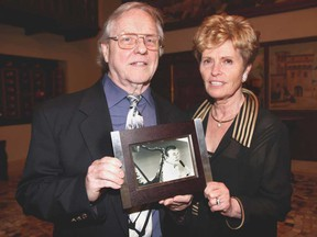 "Clayton Moore, left, and Catherine O'Brien hold a photo of George Z. Hart during a memorial event held in honour of Hart at Fogular Furlan in Windsor on Sunday, April 28, 2013. Hart, who is O'Brien's late husband, was an American politician and was known as ""the singing senator"" and was well-known for often singing at local Legions. Hart died on Jan. 31 at age 88. (REBECCA WRIGHT/ The Windsor Star)"