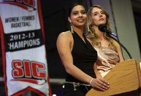 Co-female athletes of the year Miah-Marie Langlois, left, and Jessica Clemencon accept their award during the University of Windsor student athlete awards banquet at the St. Clair Centre of the Arts in Windsor Wednesday.       (TYLER BROWNBRIDGE/The Windsor Star)