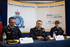 From left: Gaetan Courchesne, James Malizia and Jennifer Strachan of RCMP speak at a press conference in Toronto, Ont. on April 22, 2013. Officials revealed that two non-Canadian men have been arrested on terrorism-related charges for an alleged plot to attack VIA Rail. (Chris Young / Canadian Press)