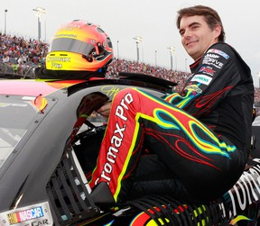 Jeff Gordon, driver of the No. 24 Cromax Pro Chevrolet, climbs into his car during the NASCAR Sprint Cup Series Bojangles' Southern 500 at Darlington Raceway in Darlington, South Carolina.  (Photo by Geoff Burke/Getty Images)