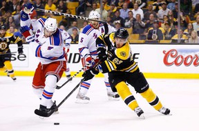 Boston's Brad Marchand, right, carries the puck around New York's Michael Del Zotto in Game 1 of the Eastern Conference Semifinals May 16, 2013 at TD Garden in Boston. (Jared Wickerham/Getty Images)