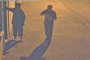 A surveillance camera image of two males who vandalized a Leamington business with graffiti on May 7, 2013. Police are asking the public to help ID the pair. (Handout / The Windsor Star)