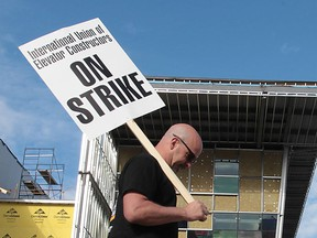 A striking member of the International Union of Elevator Constructors pickets the construction site of Windsor's Family Aquatic Complex on May 8, 2013. (Dan Janisse / The Windsor Star)