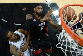 Miami's LeBron James, right, takes a shot against Kawhi Leonard of the San Antonio Spurs in Game 4. (Photo by Derick E. Hingle/Pool/Getty Images)