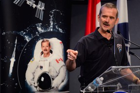 Canadian astronaut Chris Hadfield speaks at a news conference in Longueuil, Que., Monday, June 10, 2013, where he announced his plans to retire from the Canadian Space Agency. THE CANADIAN PRESS/Paul Chiasson