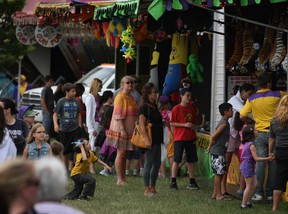 People attend the 26th Annual LaSalle Strawberry Festival at Gil Maure Park try to win prizes from the vendors, Sunday, June 9, 2013.  (DAX MELMER/The Windsor Star)