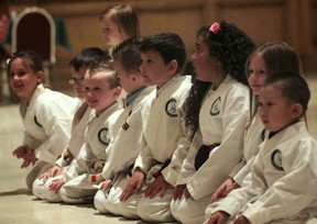 In Honour of the Ones We Love organization's Kids Beating Cancer Honourable Ninjas program held a belt ceremony Thursday, June 6, 2013, at the Ciociaro Club in Windsor, Ont. Here the kids get set to demonstrate some techniques.   (DAN JANISSE/The Windsor Star)