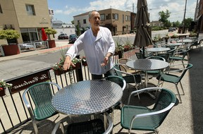Renato Zavaglia, owner of La Contessa restaurant, is seen on the patio of his restaurant in the area he hopes to put a wood burning pizza over in Windsor on Monday, June 17, 2013.               (TYLER BROWNBRIDGE/The Windsor Star)