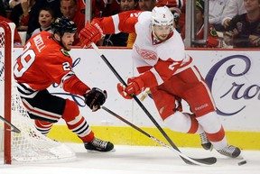 Detroit Red Wings defenceman Brendan Smith, right, tries to keep the puck from ex-Spit Bryan Bickell of the Blackhawks. (AP Photo/Nam Y. Huh)
