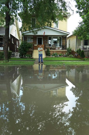 In this file photo, Paul McGrayne surveys the flooding in front of his house on Windermere Road in Windsor on Thursday, July 18, 2013. A brief storm rolled through in the early afternoon dropping massive amounts of rain and lightning.             (TYLER BROWNBRIDGE/The Windsor Star)