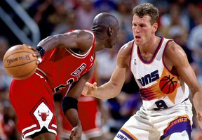 Chicago's Michael Jordan, left, is guarded by Dan Majerle of the Phoenix Suns in Game 1 of the 1993 NBA Finals.(Photo by Andrew D. Bernstein/NBAE via Getty Images)