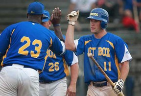 Ryan Ermers, right, of Troy Jet Box is congratulated by teammates after scoring the winning run against the Windsor Stars in the Can-Am League final at Cullen Field, Sunday, July 28, 2013.  Troy defeated Windsor 5-4 in extra innings.  (DAX MELMER/The Windsor Star)