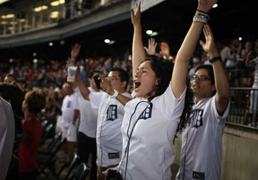 Tigers fans celebrate after Miguel Cabrera hit a walk-off home-run to beat the Kansas City Royals at Comerica Park, Saturday, August 17, 2013.  (DAX MELMER/The Windsor Star)