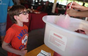 Drake Merner, 9, waits to get his hands on some cotton candy at the 9th annual Autism Ontario Windsor-Essex Summer Picnic at the Ciociaro Club, Sunday, August 25, 2013.  (DAX MELMER/The Windsor Star)