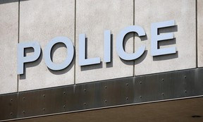 The logo above the downtown headquarters of the Windsor Police Service is shown in this 2012 file photo.