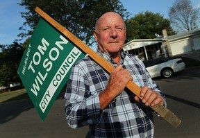 Tom Wilson holds up the only remaining election sign he still has in front of his home in Windsor on Wednesday, September 11, 2013. Wilson is running for the vacant Ward 7 seat.          (TYLER BROWNBRIDGE/The Windsor Star)
