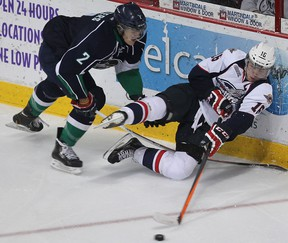Windsor's Kerby Rychel, right, is checked by Plymouth's Alex Peters at the WFCU Centr. (DAN JANISSE/The Windsor Star)