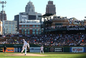 Detroit's Doug Fister, left, throws a pitch during Game 4 of the American League Division Series at Comerica Park. (Photo by Rob Carr/Getty Images)