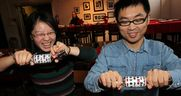 University of Windsor graduate students Shirley He, left, and Dan Liu, both of China, enjoy the festive spirit at Green Bean Cafe annual Christmas Community dinner for those who are staying around the campus of University of Windsor, December 25,  2013.  (NICK BRANCACCIO/The Windsor Star)