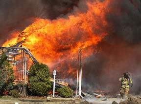 A home in the 1000 block of Esdras Place is engulfed in flames Mar. 24, 2011, in Windsor, Ont. (DAN JANISSE/The Windsor Star)