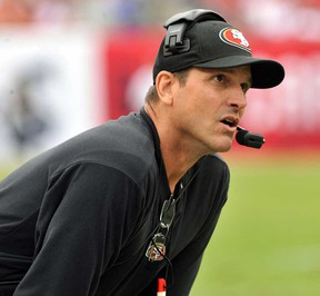 San Francisco coach Jim Harbaugh watches play against the Buccaneers December 15, 2013 in Tampa, Fla. (Al Messerschmidt/Getty Images)