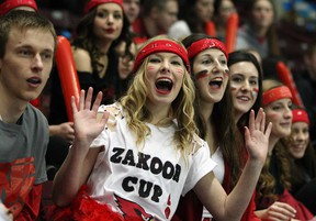 Brennen students Alex Keys, left, Justice Williamson-Deneau, Taylor Hryniw, Andrea Bisutti, Ayla Hadland and Mandy Johnstone cheer during Zakoor Cup at the WFCU Centre, Thursday December 19, 2013.  Brennan defeated St. Joseph 4-2. (NICK BRANCACCIO/The Windsor Star)