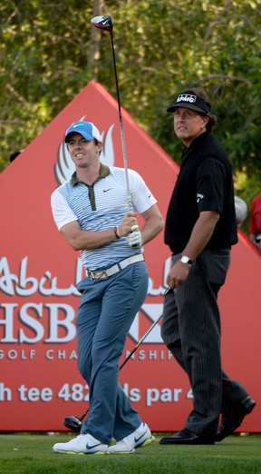 Rory McIlroy, left, and Phil Mickelson tee off on the 17th tee during the second round of the Abu Dhabi HSBC Golf Championship at the Abu Dhabi Golf Club. (Photo by Ross Kinnaird/Getty Images)