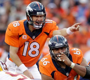 Broncos quarterback Peyton Manning, left, calls an audible at the line of scrimmage in Denver. The  Broncos face the Seattle Seahawks in the Super Bowl Feb. 2 in New York. (AP Photo/Joe Mahoney, File)
