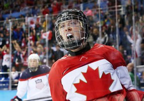 Meghan Agosta-Marciano of Canada scores Canada's third goal on Jessie Vetter of USA during third period action of the preliminary round in the Sochi 2014 Olympic Games, February 12, 2014. Photo by Jean Levac/Postmedia Olympic Team