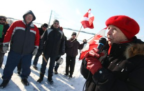 Peggy Noonan, a local activist, speaks during a small rally at Assumption Park in Windsor, Ont., Sunday, Feb. 9, 2014.  People were protesting the appeal by Detroit Bulk Storage to store petcoke along the Detroit River in Detroit.   (DAX MELMER/The Windsor Star)
