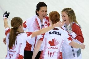 Canadian team members: Kaitlyn Lawes, left, Jill Officer, Dawn McEwen and Jennifer Jones celebrate winning gold in the Women's Curling Gold Medal Game Canada vs Sweden at the Ice Cube Curling Center during the Sochi Winter Olympics on February 20, 2014.    (JUNG YEON-JE/AFP/Getty Images)