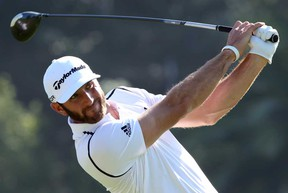 Dustin Johnson watches his shot in the first round of the Northern Trust Open at the Riviera Country Club on February 13, 2014 in Pacific Palisades, Calif. Johnson took the early lead with a 66. (Stephen Dunn/Getty Images)