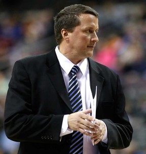 Pistons interim head coach John Loyer stands on the sideline during a game against San Antonio in Auburn Hills, Mich., Feb. 10, 2014. (AP Photo/Carlos Osorio)