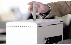 A man casts his vote in a Canadian election. (Canadian Press files)