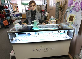 Jackie McCreary, co-owner of From the Heart on Ottawa Street, says customers are going crazy for Kameleon, a Canadian jewelry line that lets you change up your rings, pins, bracelets and pendants by popping out one stone and replacing it with another. (DAN JANISSE / The Windsor Star)