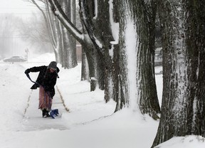 Mackenzie LaRosa, 11, shovels the sidewalk in front of her neighbour's home on Arthur Road Wednesday March 12, 2014.  LaRosa had no problem braving the cold and snowy conditions to help her mother, then help her neighbour, too!  (NICK BRANCACCIO/The Windsor Star)