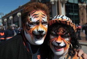 Tony and Pam Rinna, from Southgate, Michigan prepare to enter Comerica Park for the Detroit Tigers home opener against the Kansas City Royals Monday March 31, 2014 in Detroit, Michigan. (JASON KRYK/The Windsor Star)