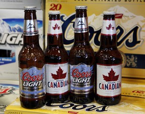 Coors Light and Molson Canadian bottles of beer, (Canadian Press files)