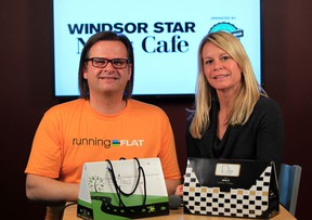 The Star's Kelly Steele with Running Flat race director Chris Uzynski, left, at News Cafe Wednesday April 16, 2014. (NICK BRANCACCIO/The Windsor Star)