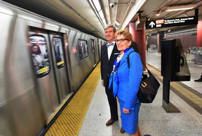 Ontario Premier Kathleen Wynne and Glen Murray, Minister of Infrastructure, wait to board the subway. THE CANADIAN PRESS/Darren Calabrese