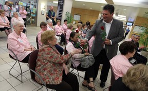 David Musyj president and CEO of Windsor Regional Hospital, presents roses to those in attendance during a service to mark the 80 years of the Windsor Regional Hospital Auxiliary at Windsor Regional Hospital in Windsor on Monday, May 12, 2014.             (TYLER BROWNBRIDGE/The Windsor Star)