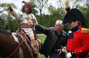 Mark Williams, centre, gives instruction David Morris, left, playing the part of Chief Tecumseh, and Scott Finlay, playing the part of Gen. Sir Isaac Brock at Paterson Park, Saturday, May 17, 2014.  Williams will be creating a statue of the two important leaders of 1812.  (DAX MELMER/The Windsor Star)